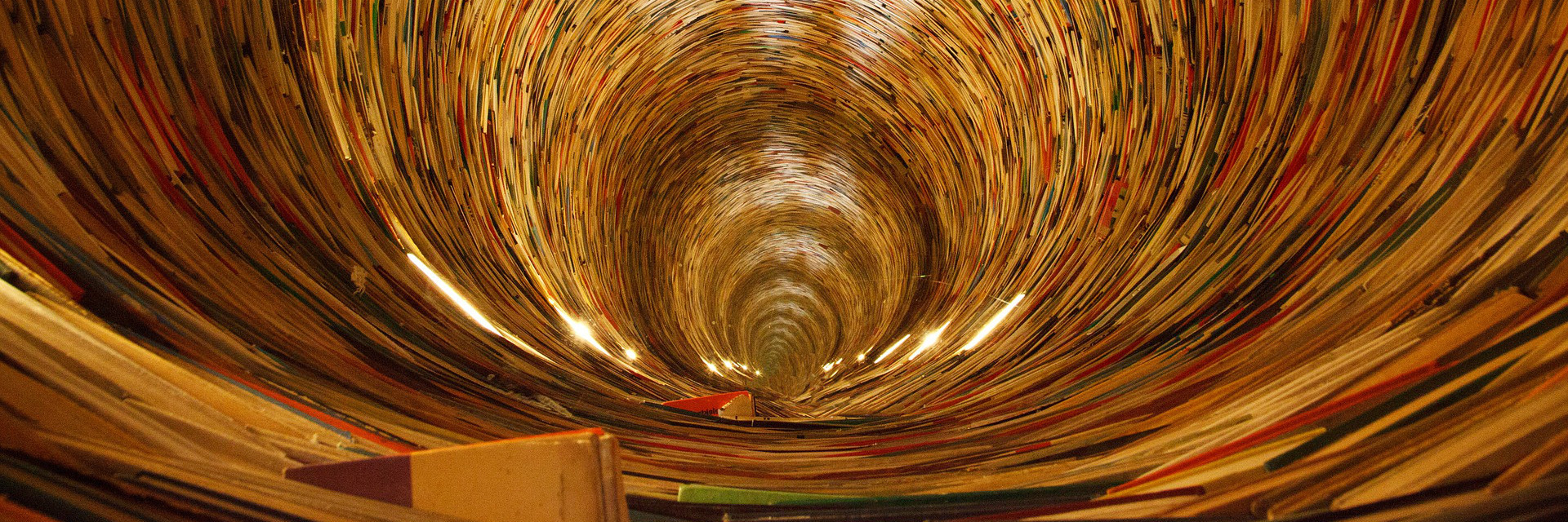 Photo of a tunnel composed of books, symbolising links to Archaeology, Prehistory and Neolithic Enclosures websites..