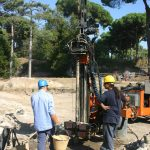 Geo-archaeologists drilling a deep core in order to sample harbour deposits at Portus (Photo: Simon Keay/ Portus Project)