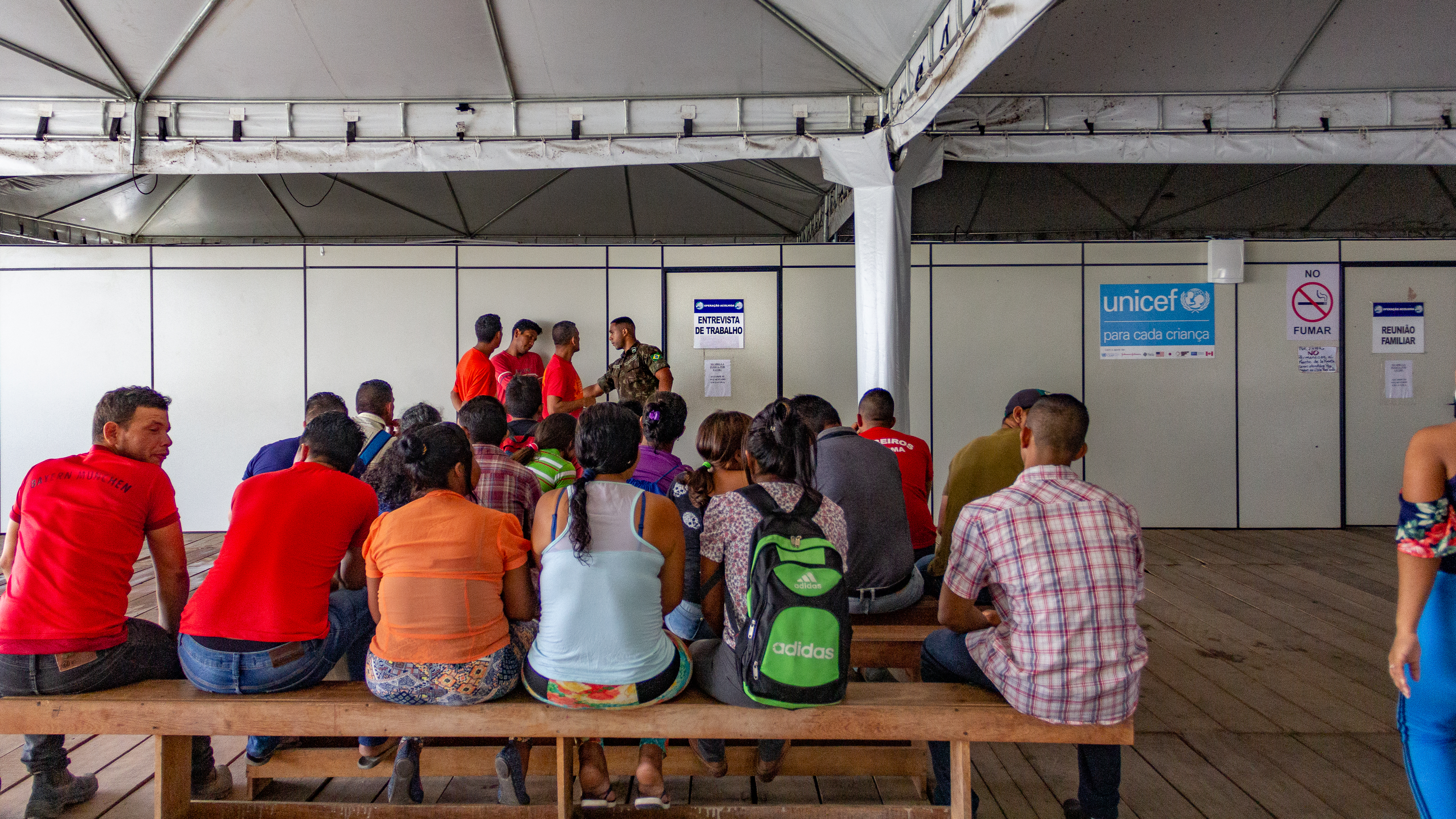 Migrants queueing for interviews inside the Registration and interiorization shelter, Boa Vista